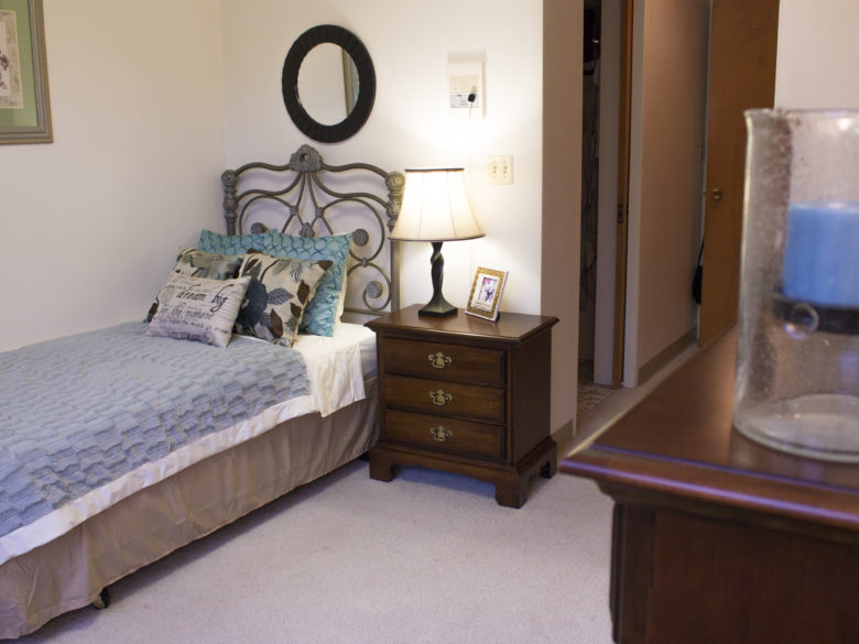 Bedroom in a one bed assisted living apartment at VMP Milwaukee.