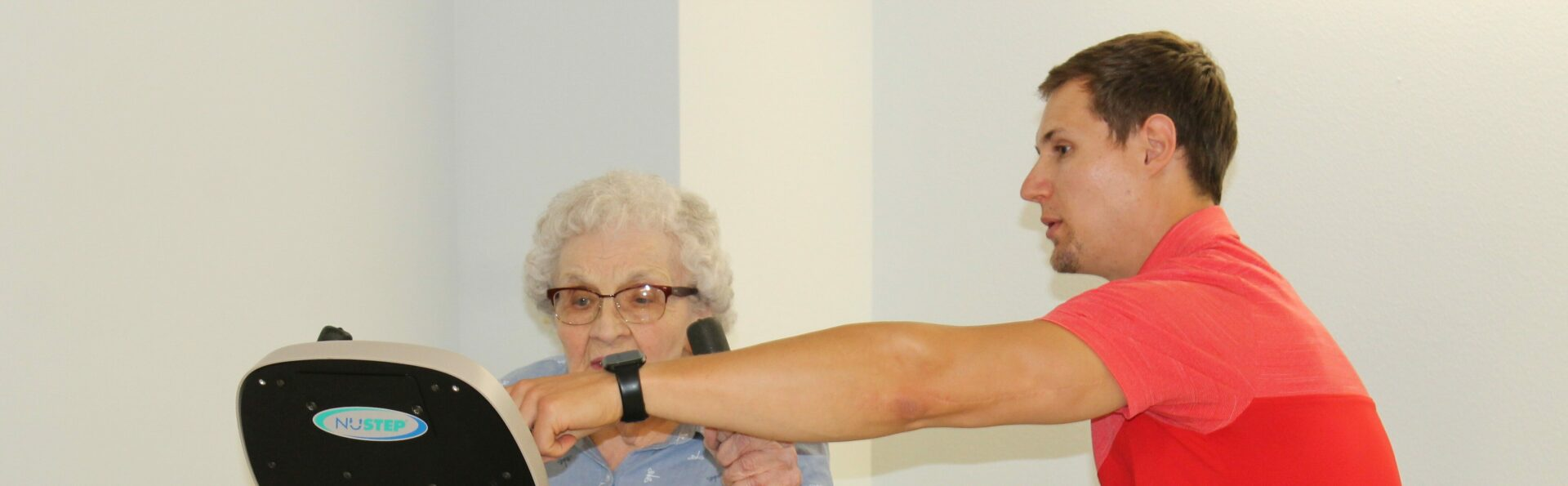 A physical therapist working with an elderly lady.