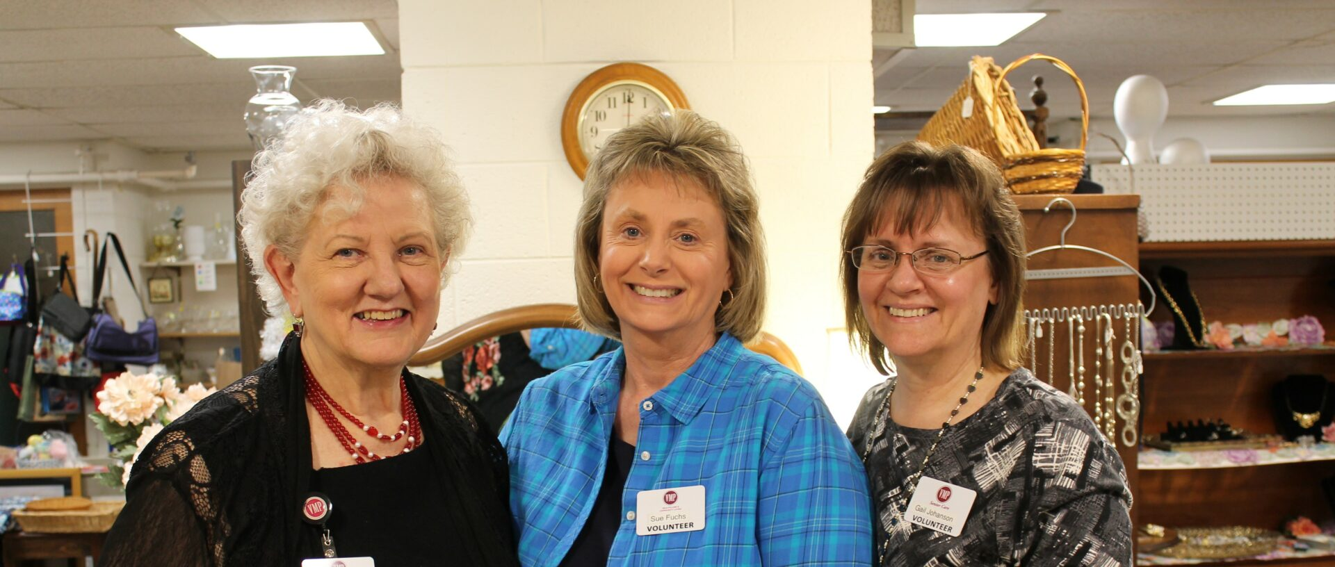 Three ladies smiling.