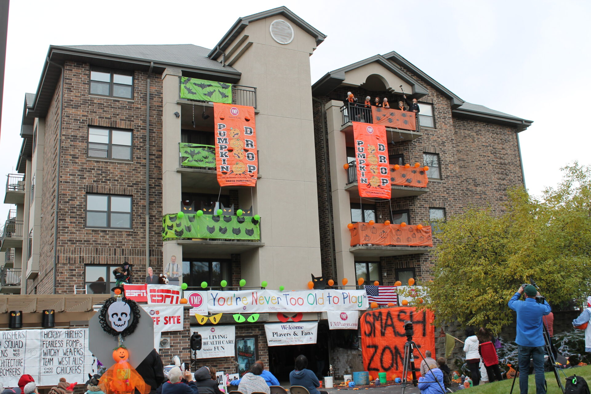 Independent Living residents throwing pumpkin off the roof for annual Pumpkin Drop